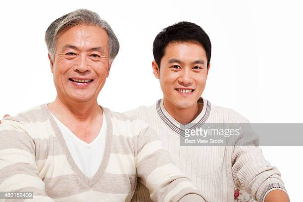 studio shot young man and his father