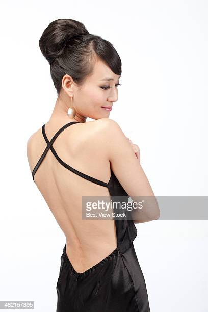 studio shot young woman in evening dress