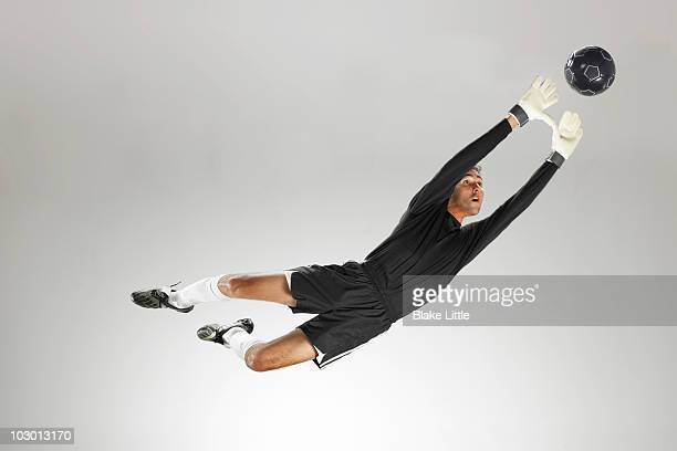 studio soccer player - goalie goalkeeper football soccer keeper stock pictures, royalty-free photos & images