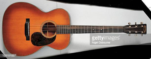Studio still life of a 1929 Martin OM18 acoustic guitar photographed in the United Kingdom
