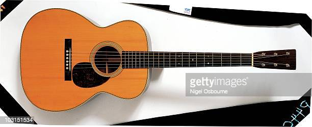 Studio still life of a 1930 Martin OM28 acoustic guitar photographed in the United Kingdom