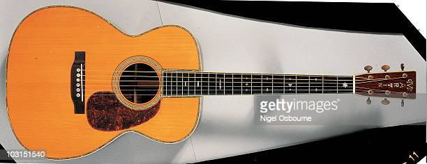 Studio still life of a 1930 Martin OM45 acoustic guitar photographed in the United Kingdom