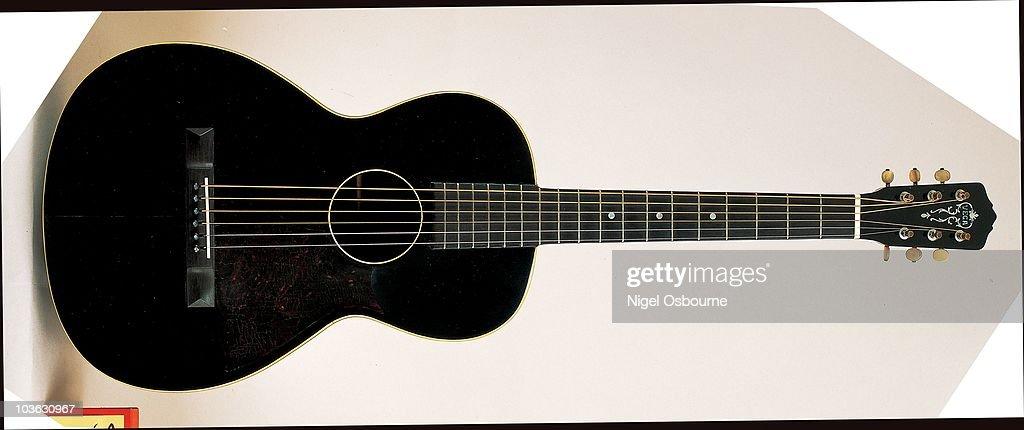 Studio still life of a 1930 Vega acoustic guitar