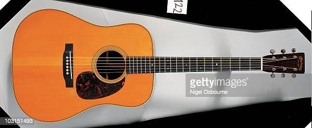 Studio still life of a 1932 Martin D28 acoustic guitar photographed in the United Kingdom