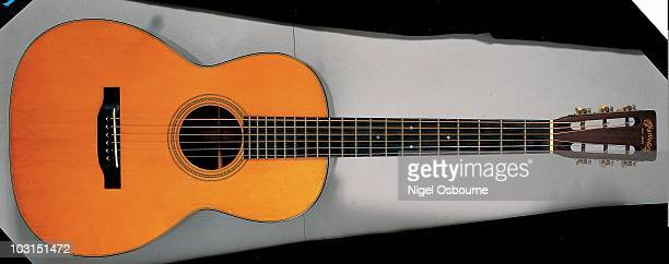 Studio still life of a 1938 Martin 0021 acoustic guitar photographed in the United Kingdom