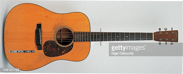 Studio still life of a 1942 Martin D18 acoustic guitar owned by Elvis Presley photographed in the United Kingdom