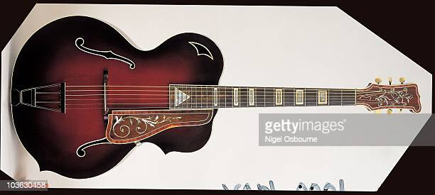 Studio still life of a 1952 Van Eps archtop guitar photographed in the United Kingdom