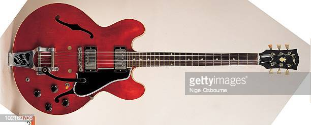 Studio still life of a 1958 Gibson ES335T guitar fitted with a Bigsby Vibrato photographed in the United Kingdom