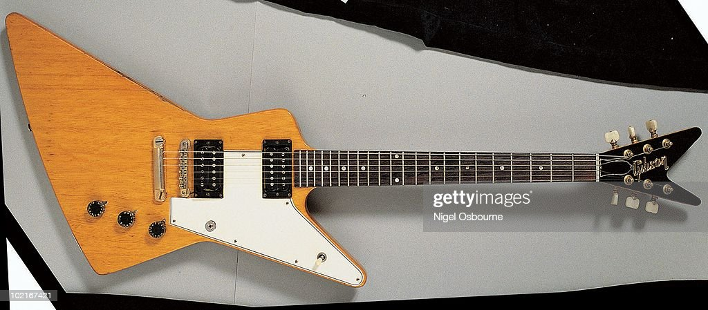 studio still life of a 1958 gibson explorer guitar photographed in