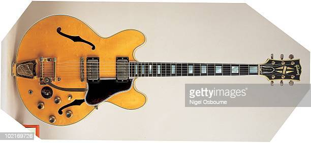 Studio still life of a 1959 Gibson ES335 TDN guitar fitted with a Bigsby Vibrato photographed in the United Kingdom