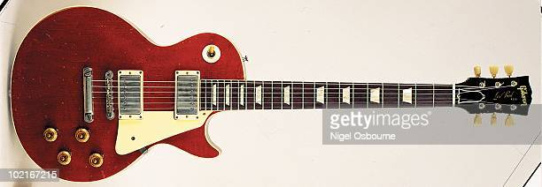 Studio still life of a 1959 Gibson Les Paul Standard guitar in cherry finish nicknamed 'Lucy' and owned by George Harrison it was given to him by...