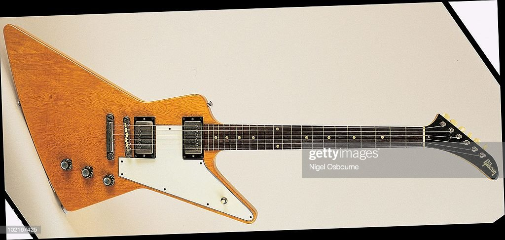 studio still life of a 1963 gibson explorer guitar photographed in