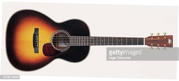 Studio still life of a 2002 Froggy Bottom H12 Deluxe acoustic guitar photographed in the United Kingdom