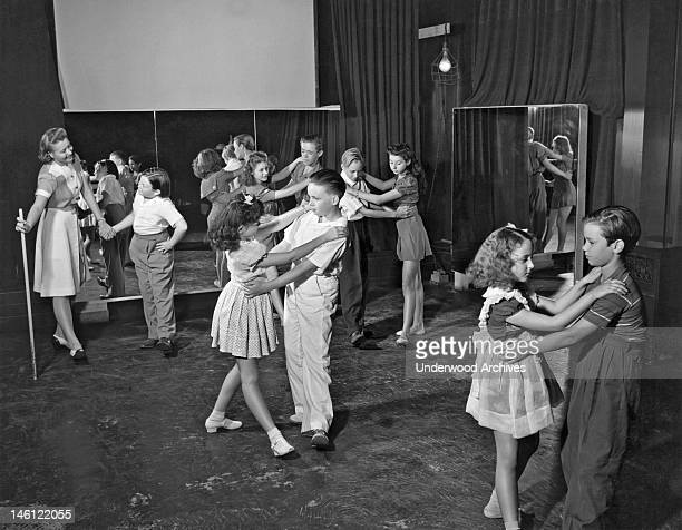 Studio Teacher Jeanette Bates gives a folk dancing lesson on the lot of MetroGoldwynMayer Studios to young actors who still have to go to school...