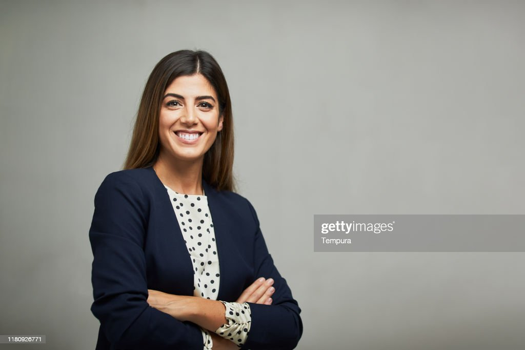 Studio waist up portrait of a smiling businesswoman with copy space. : Stock Photo