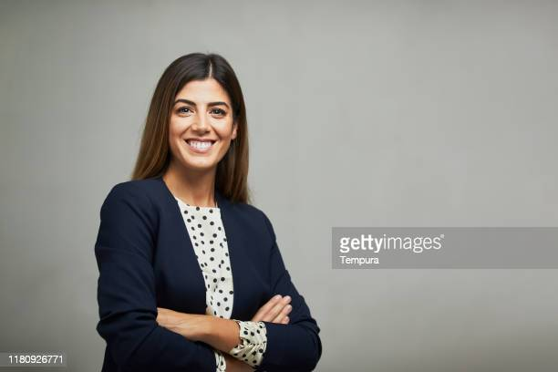 studio waist up portrait of a smiling businesswoman with copy space. - businesswoman stock pictures, royalty-free photos & images