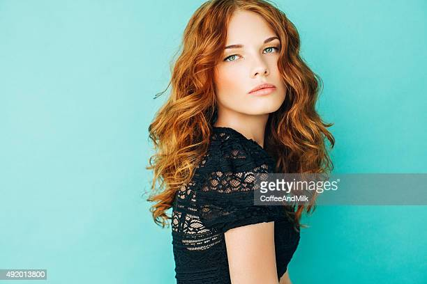 studioshot of young beautiful woman - redhead stock pictures, royalty-free photos & images