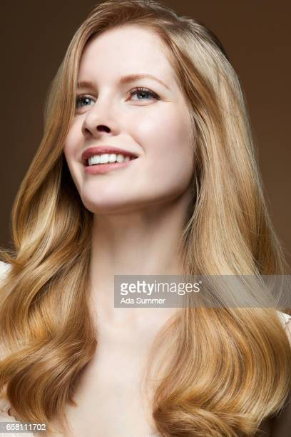 Studioshot of young beautiful woman with long blond hair