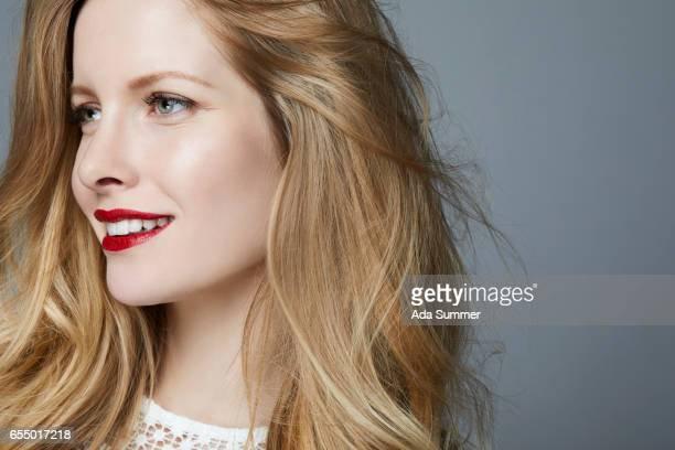 Studioshot of young beautiful woman with long blonde hair