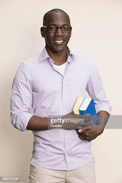 Studious man holding books
