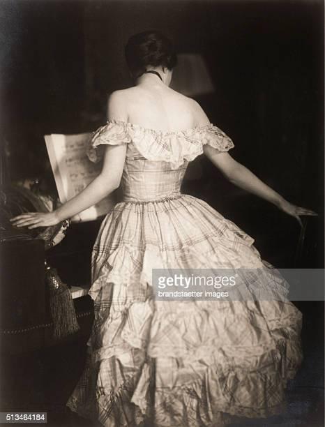 Study at the spinet' German dancer Lo Hesse circa 1918 Photograph by Franz Xaver Setzer By Franz Xaver Setzer