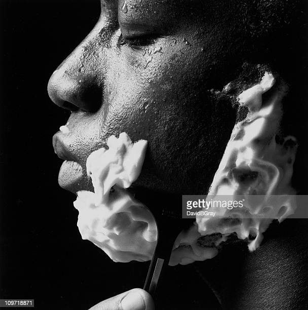 study in black and white : african american man shaving - shaving stock pictures, royalty-free photos & images
