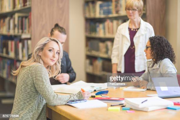 study session in library - master's degree stock pictures, royalty-free photos & images