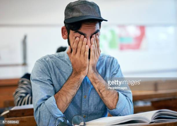 studying all night has made him tired - hands covering eyes stock pictures, royalty-free photos & images