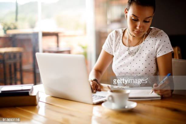 studying at a cafe - authors stock photos and pictures
