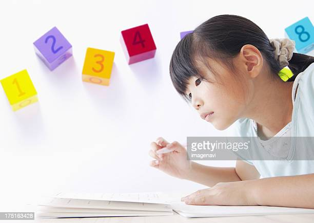 Studying elementary school girl and number blocks