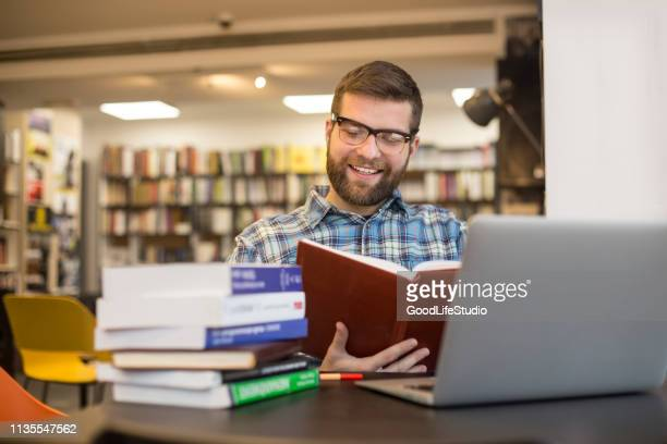 studying for exams - reading glasses stock pictures, royalty-free photos & images