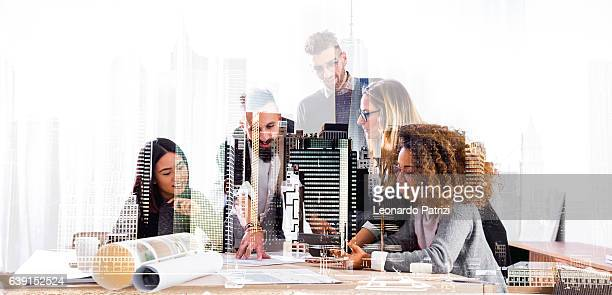 studying new business strategies till late - business strategy stock photos and pictures