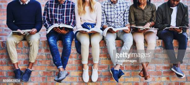studying on campus - textbook stock pictures, royalty-free photos & images