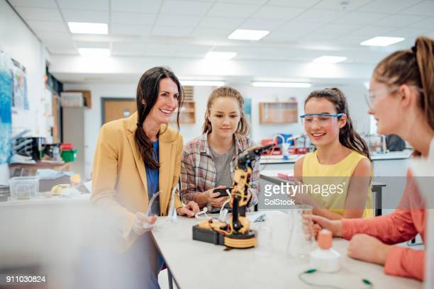 studying robotic arm - classroom stock photos and pictures