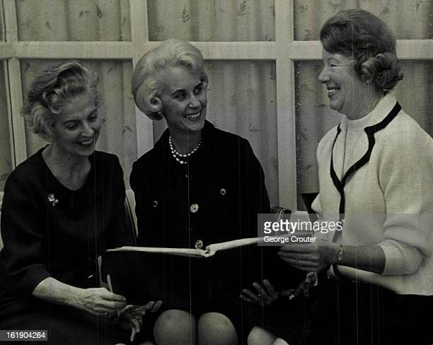 FEB 15 1965 FEB 17 1965 FEB 21 1965 Studying seating arrangements for April 20 fashion show luncheon benefiting St Luke's Hospital Auxiliary are from...