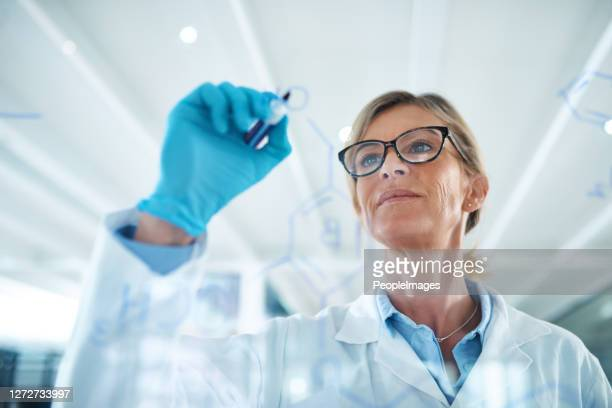 studying the composition and properties of substances and their reactions - forensicpathologist stock pictures, royalty-free photos & images