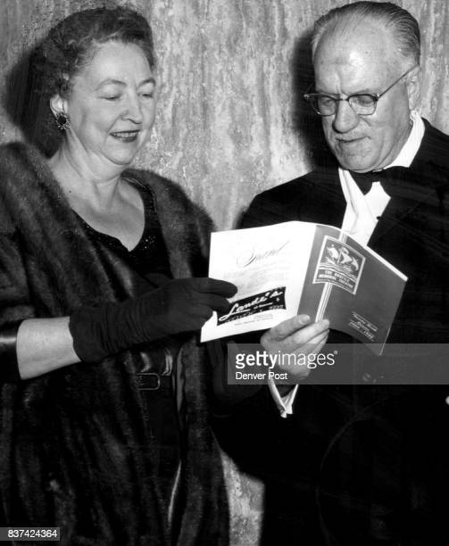 Studying the program notes before curtain time are Mr and Mrs Raymond Ervin who dined at the Denver Club before attending the opening of the family...