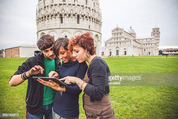Studying touristic guide of Pisa on tablet