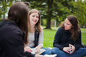 three university students study with flashcards