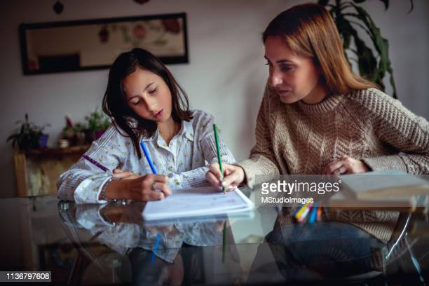 studyng at home. - mexican mothers day stock photos and pictures