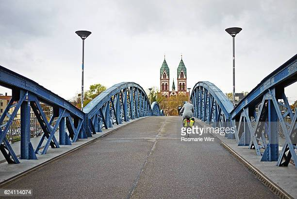 stuehlinger bruecke with view of herz jesu kirche - kirche stock pictures, royalty-free photos & images