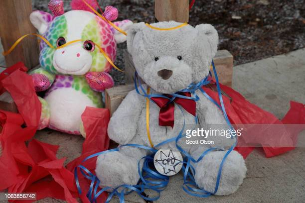 Stuffed animal sit at the base of crosses placed outside of Mercy Hospital where four people were shot and killed yesterday on November 20 2018 in...