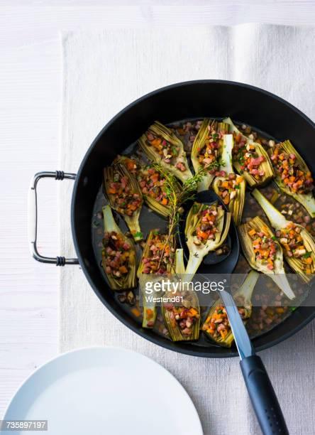 Stuffed artichokes in a pan