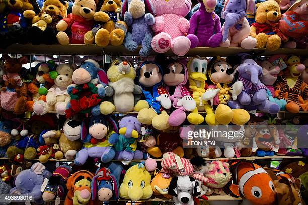 Stuffed character dolls are displayed at the MCN Comic Con in east London on October 23 2015 The event is the largest of it's type in the UK and sees...