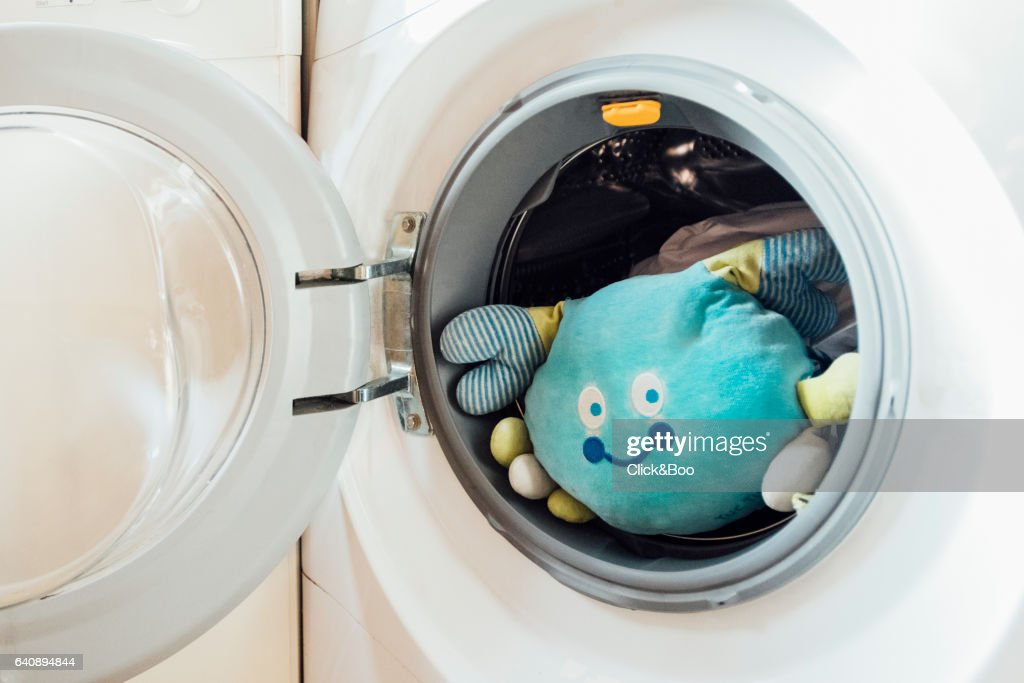 Stuffed crab inside a washing machine : ストックフォト