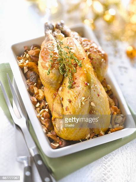 stuffed guinea-fowl with wild mushrooms and hazelnuts - guinea fowl stock pictures, royalty-free photos & images