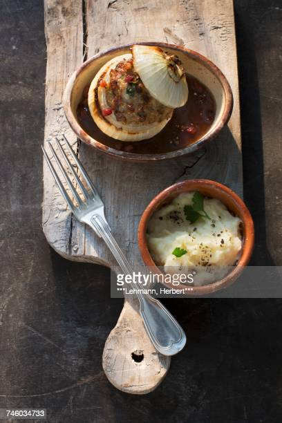 Stuffed onions in a beer sauce with mashed potatoes