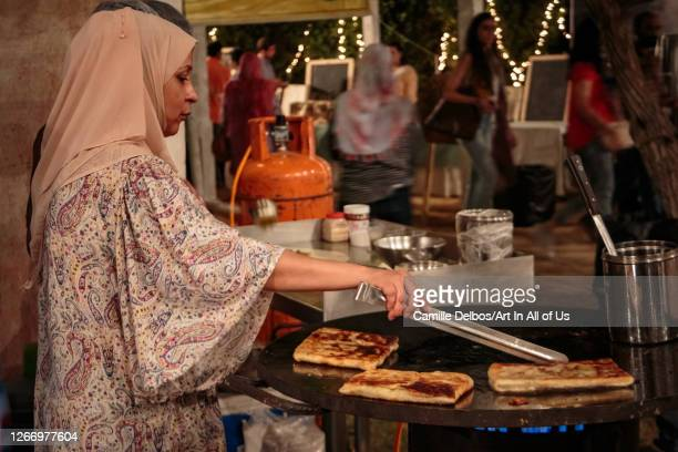 Stuffed paratha cooked on a festival stand by a woman wearing an veil on Avril 23, 2016 in Karachi, Sindh, Pakistan.