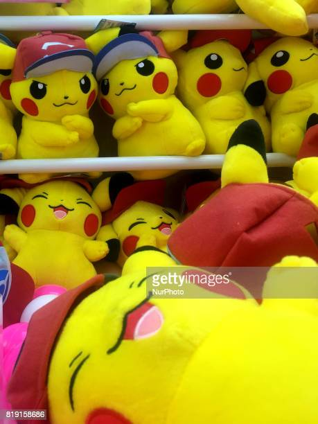 Stuffed Pikachu toys a Pokemon fictional character are stacked in a game center in Tokyo Japan July 19 2017