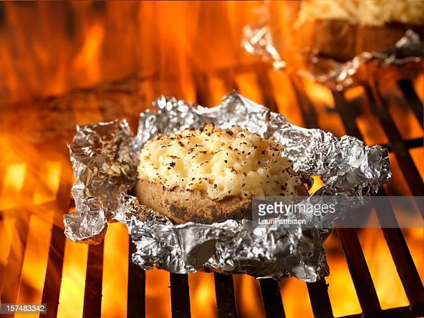 stuffed potatoes on the bbq - prepared potato stock pictures, royalty-free photos & images